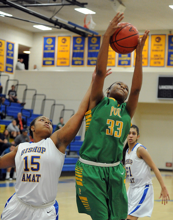 . Long Beach Poly\'s Mahogany Brown (33) rebounds over Bishop Amat\'s Leeah Powell (15) in the second half of a CIF State Southern California Regional semifinal basketball game at Bishop Amat High School on Tuesday, March 12, 2013 in La Puente, Calif. Long Beach Poly won 52-34.  (Keith Birmingham Pasadena Star-News)