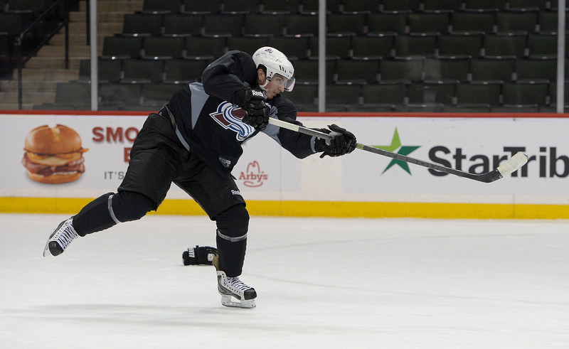 . Colorado Avalanche center Matt Duchene (9) takes a shot on goal after practice April 23, 2014 at Xcel Energy Center. (Photo by John Leyba/The Denver Post)
