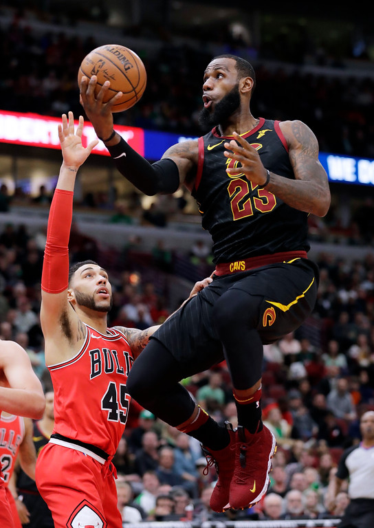 . Cleveland Cavaliers forward LeBron James, right, drives to the basket against Chicago Bulls guard Denzel Valentine during the first half of an NBA basketball game Saturday, March 17, 2018, in Chicago. (AP Photo/Nam Y. Huh)