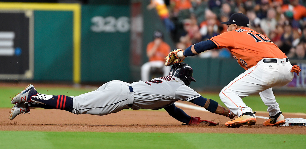 . Cleveland Indians\' Francisco Lindor, left, is picked off by Houston Astros first baseman Yuli Gurriel during the first inning of a baseball game, Friday, May 19, 2017, in Houston. (AP Photo/Eric Christian Smith)