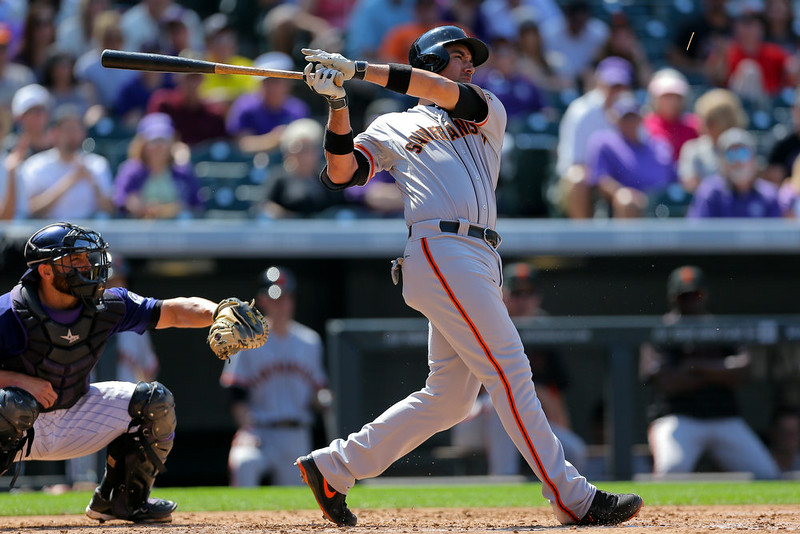 . Travis Ishikawa #45 of the San Francisco Giants hits an RBI single during the eighth inning against the Colorado Rockies at Coors Field on September 1, 2014 in Denver, Colorado. The teams were resuming a game previously suspended in the sixth inning on May 22 due to rain.  (Photo by Justin Edmonds/Getty Images)