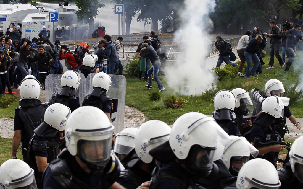 . Turkish university students, who were protesting the explosions that killed tens of people in Reyhanli near the border with Syria last week, clashed with riot police at the Middle East Technical University in Ankara, Turkey, Wednesday, May 15, 2013.(AP Photo)