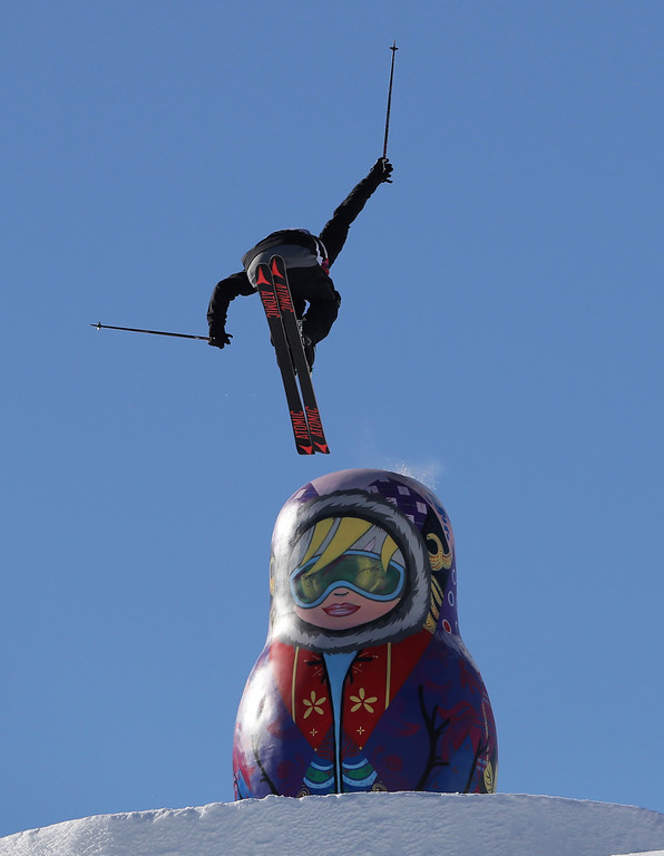 . A competitor takes a jump near a giant matryoshka doll during a ski slopestyle training session at the Rosa Khutor Extreme Park, prior to the 2014 Winter Olympics, Tuesday, Feb. 4, 2014, in Krasnaya Polyana, Russia. (AP Photo/Sergei Grits)