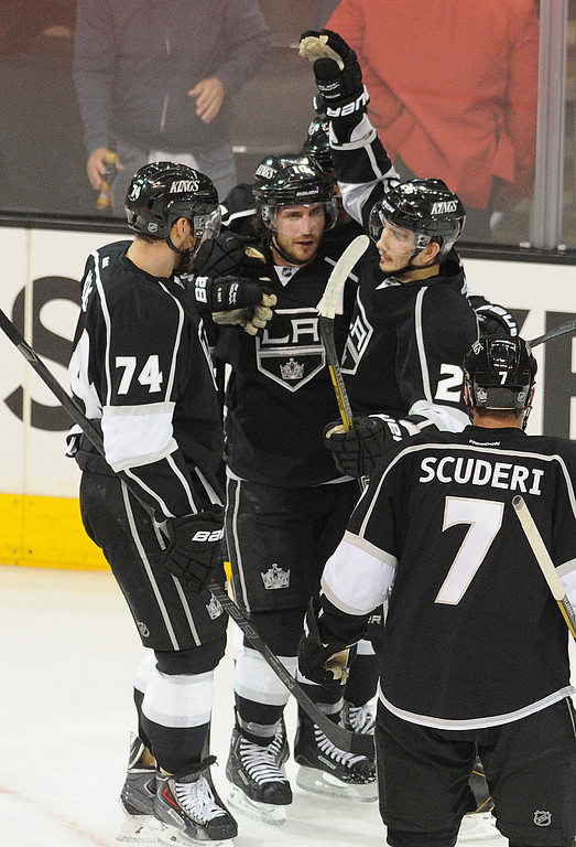 . Kings#26 Slava Voynov is congratulated for his goal in the final seconds of the 1st period. The Kings played the San Jose Sharks during the first game in the Second Round of the Western Conference Playoffs. Los Angeles CA 5/14/2013(John McCoy/LA Daily News)
