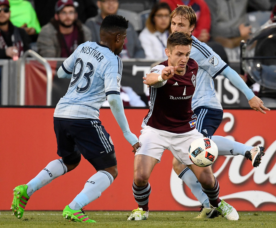 . COMMERCE CITY, CO - MAY 11: Sony Mustivar (93) of Sporting Kansas City and Seth Sinovic (15) defend Kevin Doyle (9) of Colorado Rapids during the first half of action. The Colorado Rapids hosted Sporting Kansas City on Wednesday, May 11, 2016. (Photo by AAron Ontiveroz/The Denver Post)