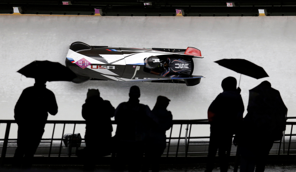 . The team from the United States USA-3, piloted by Jazmine Fenlator with brakeman Lolo Jones, speed down the track in the rain during the women\'s two-man bobsled competition at the 2014 Winter Olympics, Tuesday, Feb. 18, 2014, in Krasnaya Polyana, Russia. (AP Photo/Natacha Pisarenko)