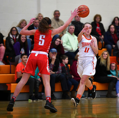 12/26/2019 Mike Orazzi | StaffrTerryville High School's Kassandra McCarthy (11) and Northwestern's Natalie Brodnitzki (5) during Thursday's girls basketball game in Terryville.