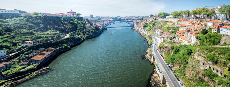 Panoramic view of the Douro river, the Luis I bridge and the city of Porto from Infante bridge, Portugal.
