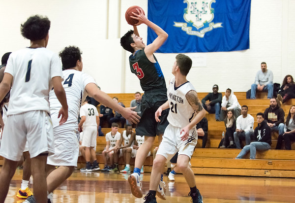 12/27/18 Wesley Bunnell   Staff Newington basketball vs St. Paul on Thursday evening played at Farmington High School. Will Barton (3) with a jump shot.