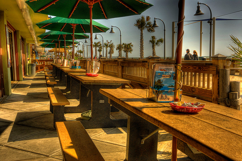 Outdoor seating at Oceanfront Bar & Grill on the Boardwalk in Myrtle Beach, SC on Saturday, March 10, 2012. Copyright 2012 Jason Barnette