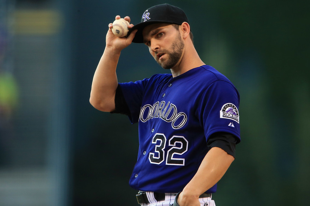 . DENVER, CO - JULY 26:  Starting pitcher Tyler Chatwood #32 of the Colorado Rockies works against the Milwaukee Brewers at Coors Field on July 26, 2013 in Denver, Colorado.  (Photo by Doug Pensinger/Getty Images)