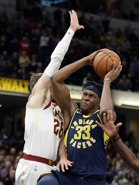 . Indiana Pacers\' Myles Turner (33) goes to the basket against Cleveland Cavaliers\' Kyle Korver during the second half of an NBA basketball game, Friday, Dec. 8, 2017, in Indianapolis. The Pacers won 106-102. (AP Photo/Darron Cummings)