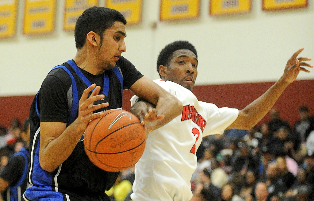 . 02-23-2012--(LANG Staff Photo by Sean Hiller)- Palisades vs. Westchester in Saturday\'s L.A. City Section Division I semifinal boys basketball game at Cal State Dominguez Hills in Carson. Palisades\' Ammar Rehman (22) battles Westchester\'s Darnell Brown (2).