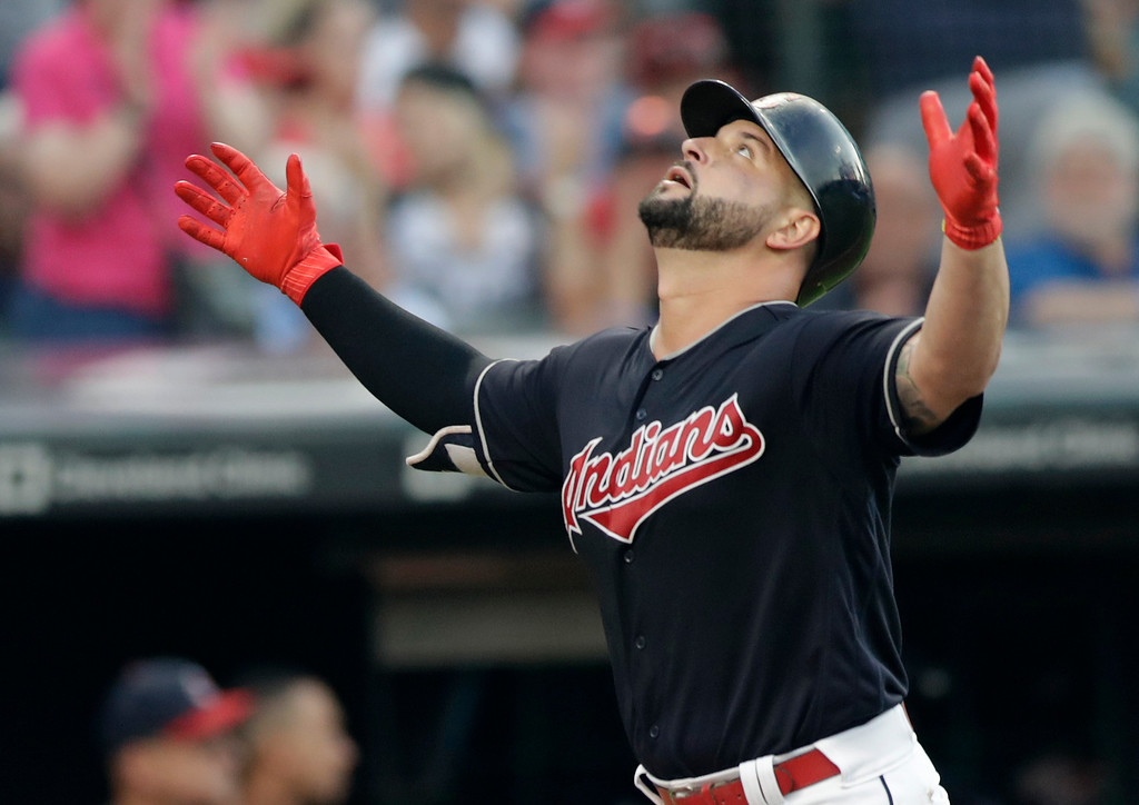 . Cleveland Indians\' Yonder Alonso celebrates after hitting a solo home run off Cincinnati Reds starting pitcher Anthony DeSclafani in the fourth inning of a baseball game, Monday, July 9, 2018, in Cleveland. (AP Photo/Tony Dejak)