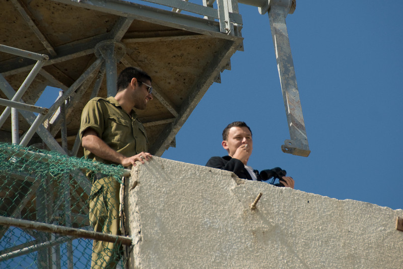 Men viewing the city from top of building - Israel