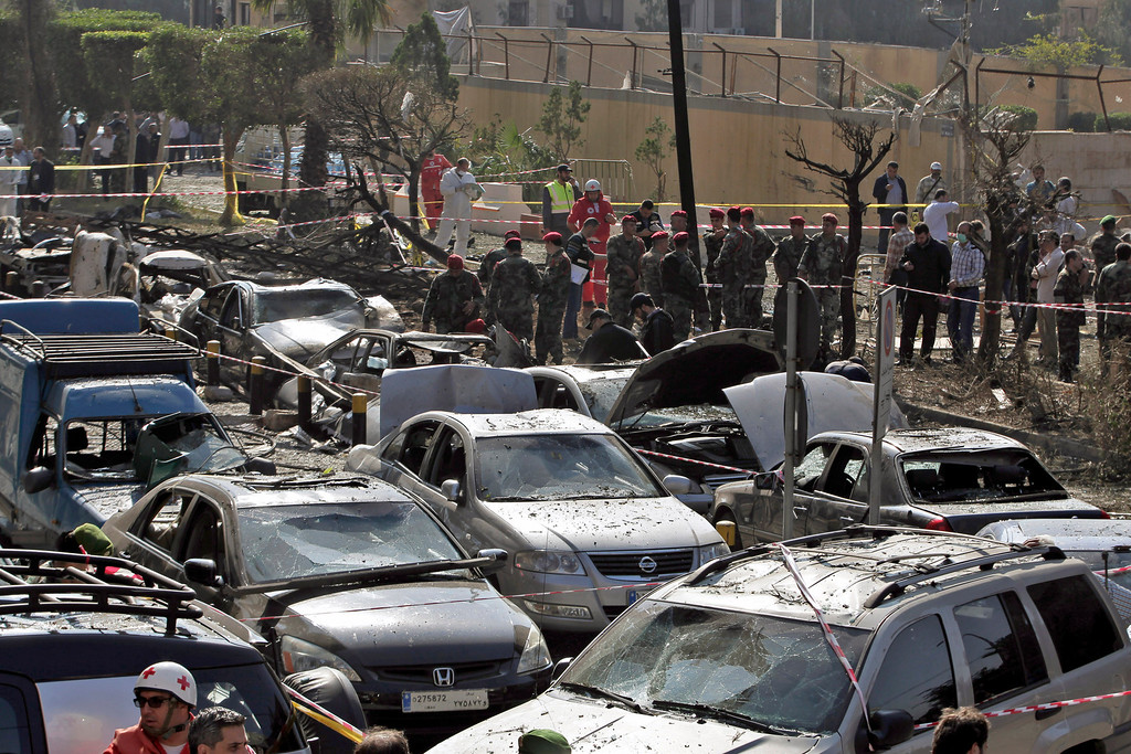 . Lebanese army investigators inspect at the scene where two explosions have struck near the Iranian Embassy killing nearly two dozen, in Beirut, Lebanon, Tuesday, Nov. 19, 2013.  (AP Photo/Bilal Hussein)