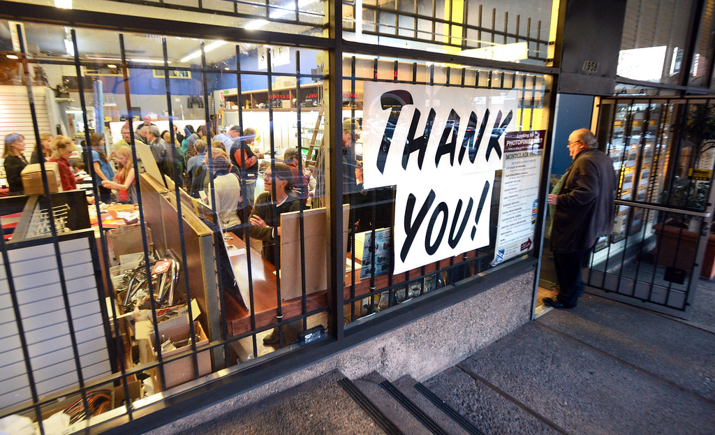 ". A ""Thank You!\"" sign is posted on the front window during a farewell event for Sarber\'s Cameras in Oakland, Calif., on Friday, Feb. 1, 2013. The store was bought in 1961 by Peter and Nancy Sarber and moved to Montclair in 1964. After more than a half-century in business, Sarber\'s Cameras is closing. The Sarber family held the farewell event for longtime customers, friends and family in Montclair Village. (Doug Duran/Staff)"