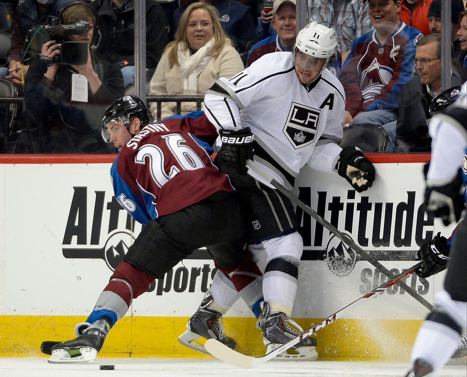 . Colorado Avalanche center Paul Stastny (26) and Los Angeles Kings center Anze Kopitar (11) battle for the puck along the boards during the first period February 27, 2014 at Pepsi Center. (Photo by John Leyba/The Denver Post)
