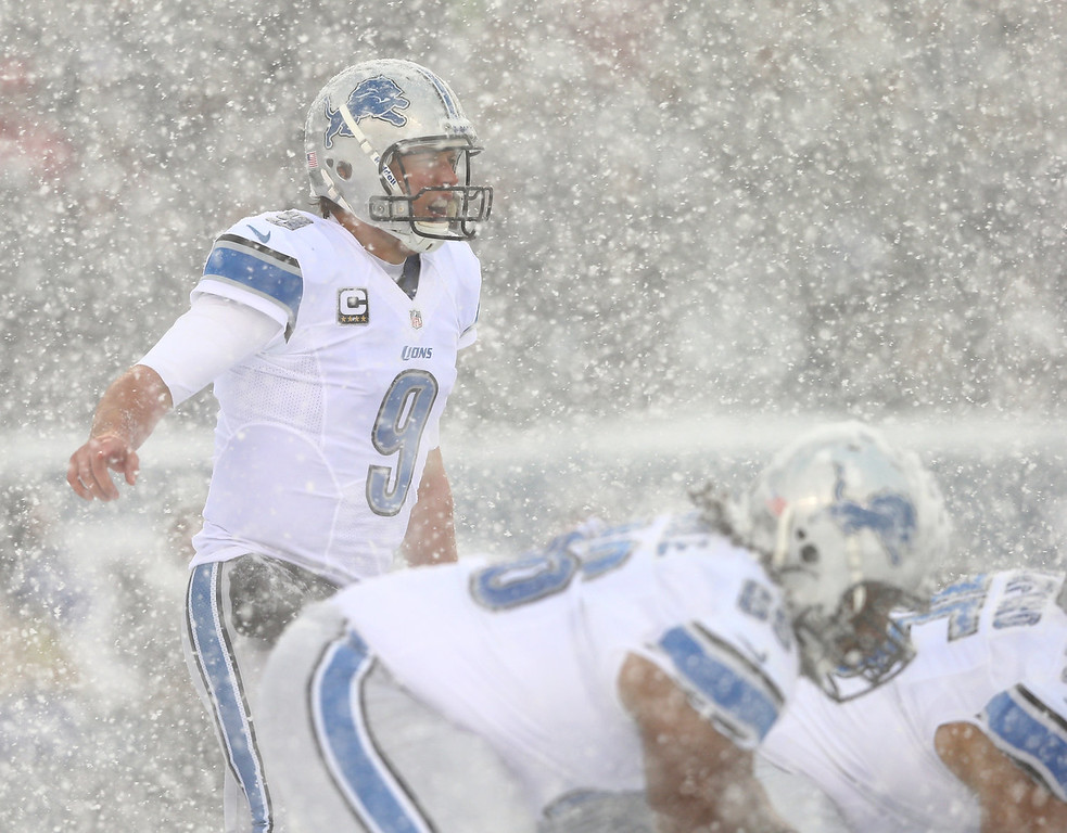 . Matthew Stafford #9 of the Detroit Lions calls out the play in the first quarter against the Philadelphia Eagles  on December 8, 2013 at Lincoln Financial Field in Philadelphia, Pennslyvania.  (Photo by Elsa/Getty Images)
