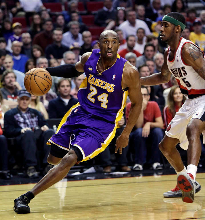 . Los Angeles Lakers guard Kobe Bryant, left, drives on Portland Trail Blazers guard Will Barton during the first quarter of an NBA basketball game in Portland, Ore., Wednesday, April 10, 2013. (AP Photo/Don Ryan)