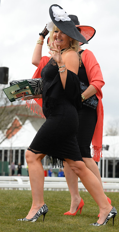 . Racegoers pose as they attend Ladies Day the second day of the Grand National Meeting horse racing event at Aintree Racecourse in Liverpool, north-west England on April 5, 2013. The annual three day meeting culminates in the Grand National which is run over a distance of four miles and four furlongs (7,242 metres), and is the biggest betting race in the United Kingdom.  ANDREW YATES/AFP/Getty Images