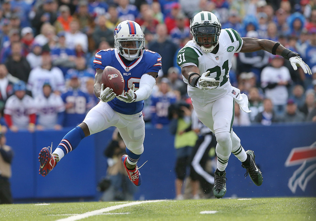 . Marquise Goodwin #88 of the Buffalo Bills cannot catch a pass during NFL game action as Antonio Cromartie #31 of the New York Jets defends at Ralph Wilson Stadium on November 17, 2013 in Orchard Park, New York. (Photo by Tom Szczerbowski/Getty Images)