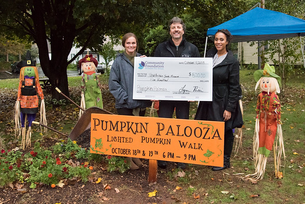 10/09/19 Wesley Bunnell | StaffrrThe Community Foundation of Greater New Britain donated five hundred dollars to the Youth Museum at Hungerford Park in support of their Pumpkin Palooza event taking place October 18 & 19th from 6pm to 9pm. Foundation Office Manager and Scholarship Associate Candice Tabone, Executive Director of the New Britain Youth Museum at Hungerford Park Tom Pascocello and foundation Assistant Director of Development Kaylah Smith.