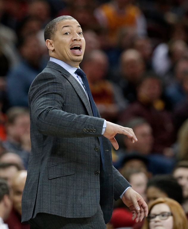 . Cleveland Cavaliers head coach Tyronn Lue yells instructions to players in the second half of an NBA basketball game against the Detroit Pistons, Tuesday, March 14, 2017, in Cleveland. The Cavaliers won 128-96. (AP Photo/Tony Dejak)