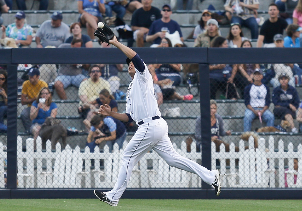 . San Diego Padres right fielder Kyle Blanks makes the running catch of a line drive hit by Colorado Rockies\' Charlie Blackmon in the first inning of a baseball game in San Diego, Tuesday, July 9, 2013. (AP Photo/Lenny Ignelzi)