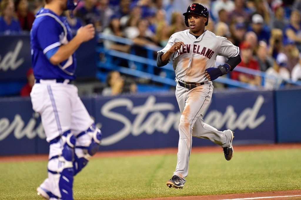 . Cleveland Indians\' Greg Allen runs in to score on a single by Jose Ramirez against the Toronto Blue Jays during the fifth inning of a baseball game Friday, Sept. 7, 2018, in Toronto. (Frank Gunn/The Canadian Press via AP)