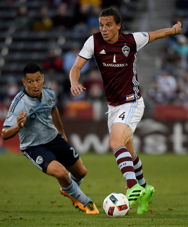 . COMMERCE CITY, CO - MAY 11: Marc Burch (4) of Colorado Rapids controls the ball as Roger Espinoza (27) of Sporting Kansas City defends during the first half of action. The Colorado Rapids hosted Sporting Kansas City on Wednesday, May 11, 2016. (Photo by AAron Ontiveroz/The Denver Post)