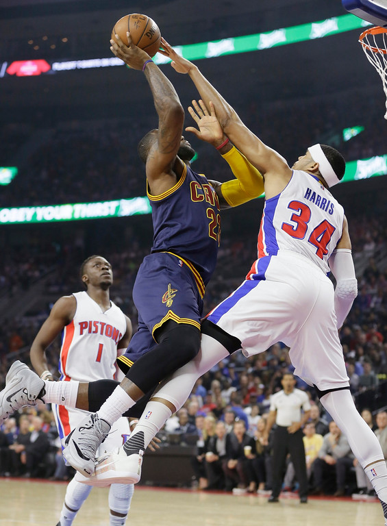. Cleveland Cavaliers forward LeBron James is fouled by Detroit Pistons forward Tobias Harris (34) during the first half in Game 4 of a first-round NBA basketball playoff series, Sunday, April 24, 2016 in Auburn Hills, Mich. (AP Photo/Carlos Osorio)