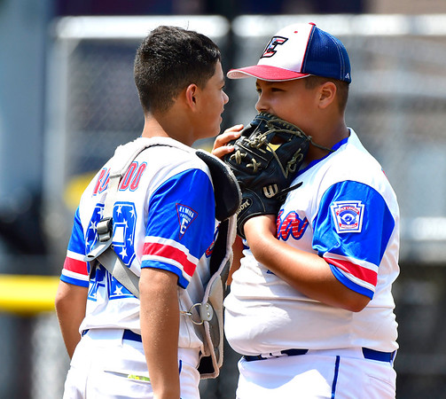 8/7/2019 Mike Orazzi | Staff New Jersey's Derek Escobar (2) and J.R. Rosado (42) during a win over Pennsylvania at the Eastern Regional Little League Baseball Tournament at Breen Field in Bristol.