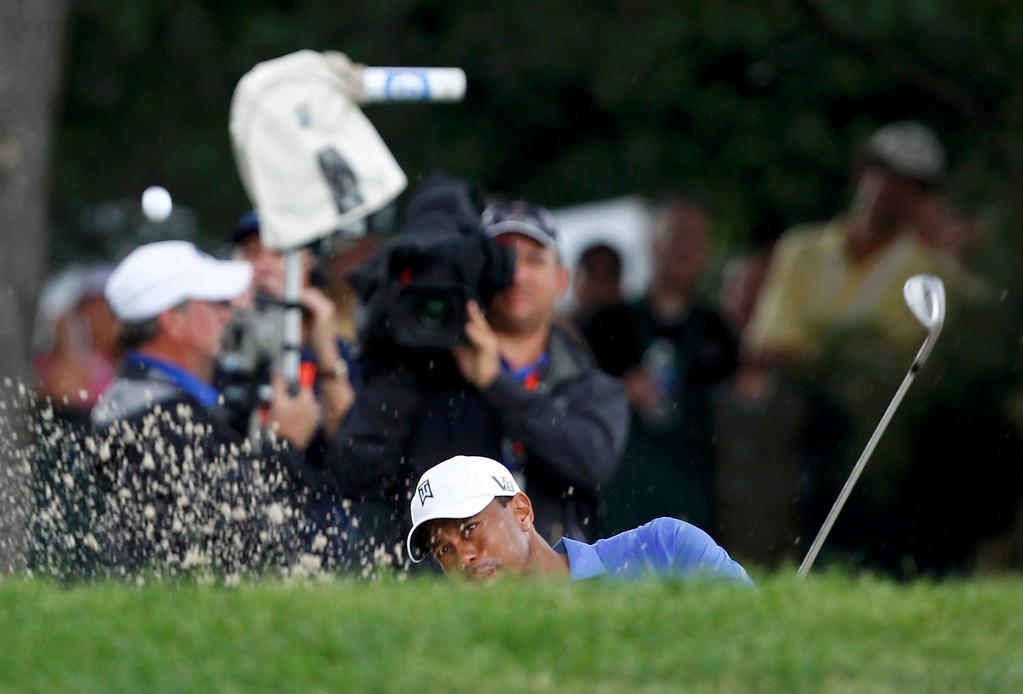 . Tiger Woods of the U.S. hits from a bunker to the second green during the first round of the 2013 U.S. Open golf championship at the Merion Golf Club in Ardmore, Pennsylvania, June 13, 2013. REUTERS/Matt Sullivan