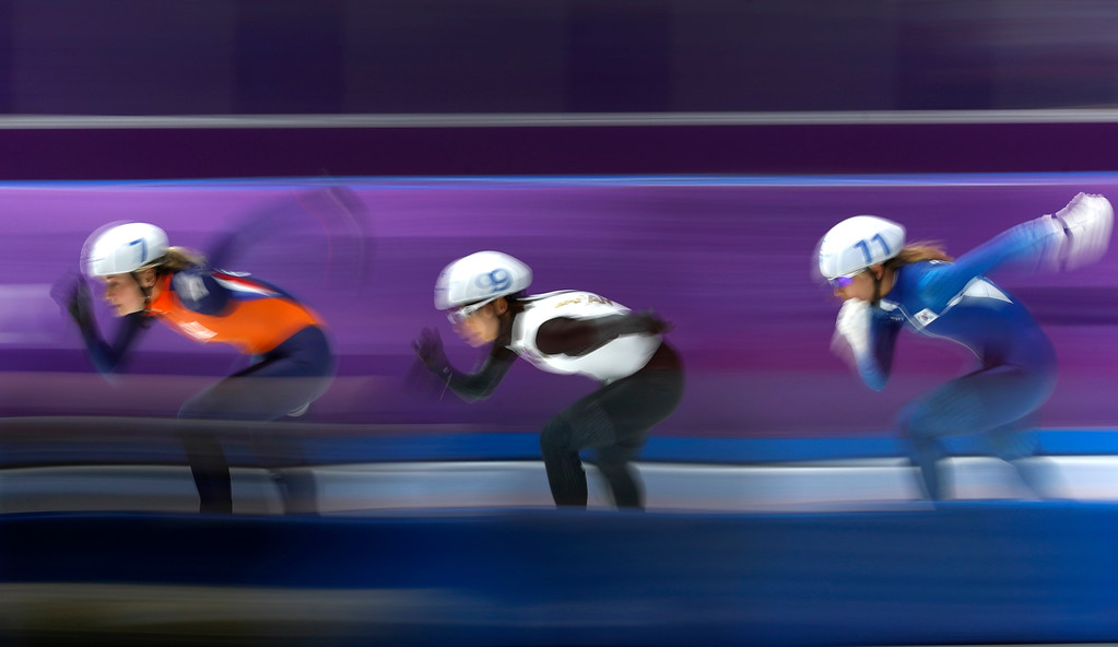 . Gold medalist Nana Takagi of Japan, center, silver medalist Kim Bo-reum of South Korea, right, and bronze medalist Irene Schouten of The Netherlands, left, compete during the women\'s mass start speedskating race at the Gangneung Oval at the 2018 Winter Olympics in Gangneung, South Korea, Saturday, Feb. 24, 2018. (AP Photo/John Locher)