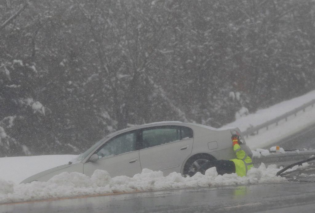 . A tow truck operator attempts to remove a car that crashed during a massive blizzard in the median of Highway 50 near Winchester, Virginia, outside of Washington, March 6, 2013. REUTERS/Gary Cameron