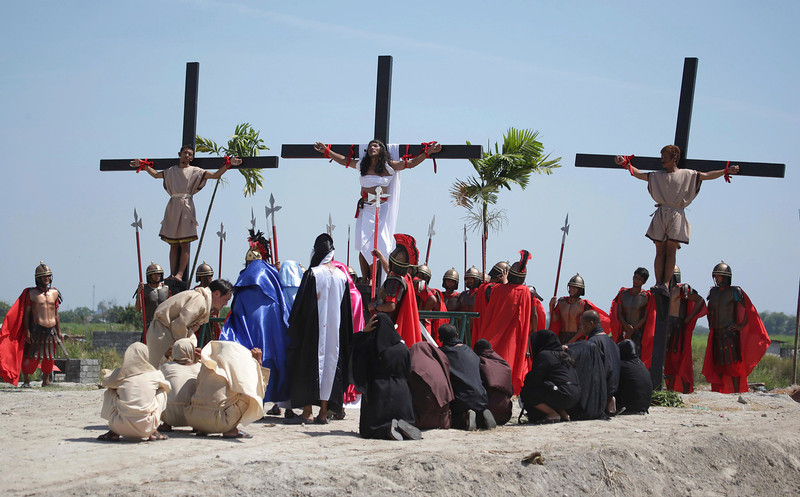 . Filipino penitent Ruben Enaje, center, who has portrayed as Jesus Christ for 27 times, is nailed on the cross as he leads others in a reenactment of the crucifixion of Jesus Christ during Good Friday rituals on March 29, 2013 at Cutud, Pampanga province, northern Philippines. Several Filipino devotees had themselves nailed to crosses Friday to remember Jesus Christ\'s suffering and death, an annual rite rejected by church leaders in this predominantly Roman Catholic country. (AP Photo/Aaron Favila)