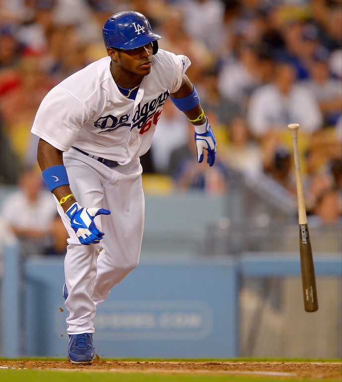 . Los Angeles Dodgers\' Yasiel Puig hits a single during the third inning of a baseball game against the Colorado Rockies, Thursday, July 11, 2013, in Los Angeles.  (AP Photo/Mark J. Terrill)
