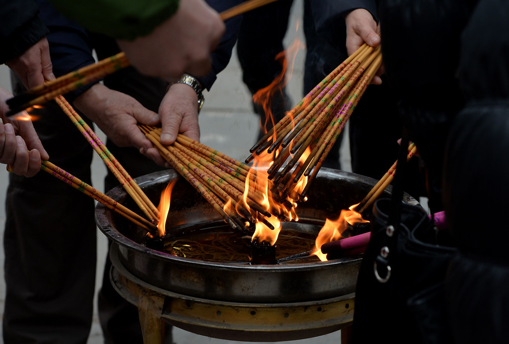 . Chinese worshippers burn joss sticks at the Dongyue Temple in the hope that it brings them prosperity and good fortune for the Year of the Horse in Beijing on January 31, 2014.         AFP PHOTO/Mark RALSTON/AFP/Getty Images