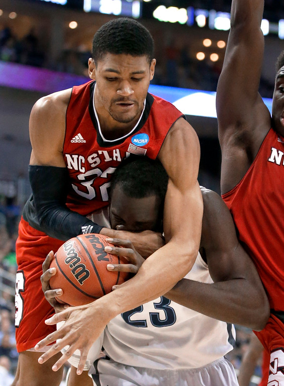 . Villanova\'s Daniel Ochefu (23) is fouled by North Carolina State\'s Kyle Washington (32) during the first half of an NCAA tournament third-round college basketball game, Saturday, March 21, 2015, in Pittsburgh. (AP Photo/Gene J. Puskar)