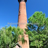 "Currituck Beach Lighthouse <br /> On December 1, 1875 the beacon of the Currituck Beach Lighthouse filled the remaining ""dark space"" on the North Carolina coast between the Cape Henry light to the north and Bodie Island to the south. To distinguish the Currituck Beach Lighthouse from other regional lighthouses, its exterior was left unpainted and gives today's visitor a sense of the multitude of bricks used to form the structure. The lighthouse was automated in 1939 when the United States Coast Guard assumed the duties of the Bureau of Lighthouses. At a height of 158 feet, the night beacon still flashes at 20-second intervals to warn ships hugging the chain of barrier islands along the coast."