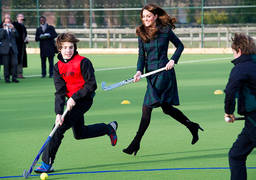 ". Kate, the Duchess of Cambridge, centre,  plays hockey during her visit to St. Andrew\'s School, where she  attended school from 1986 till 1995, in Pangbourne, England, Friday, Nov. 30, 2012. The Duchess of Cambridge has gone back to school. The royal, formerly known as Kate Middleton, played hockey and revealed her childhood nickname - Squeak - when she returned to her elementary school for a visit Friday. Kate told teachers and students at the private St. Andrew\'s School in southern England that her 10 years there were ""some of my happiest years.\"" She said that she enjoyed it so much that she had told her mother she wanted to return as a teacher. (AP Photo/Arthur Edwards)"