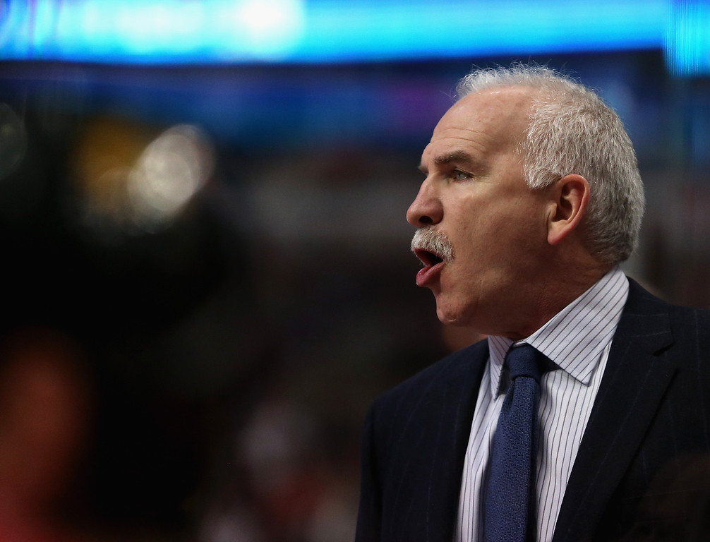 . CHICAGO, IL - DECEMBER 27:  Head coach Joel Quenneville of the Chicago Blackhawks gives instructions to his team against the Colorado Avalanche at the United Center on December 27, 2013 in Chicago, Illinois.  (Photo by Jonathan Daniel/Getty Images)
