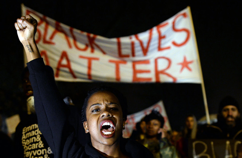 . Demonstrators shout slogans during a march in St. Louis, Missouri, on November 23, 2014 to protest the death of 18-year-old Michael Brown. More than 100 protesters marched peacefully through St Louis on November 23, stepping up pressure on a grand jury to indict a white police officer for shooting dead an unarmed black teenager. Police stepped up security and erected barricades bracing for the worst with a grand jury to decide whether to indict the police officer. Brown was shot at least six times by police officer Darren Wilson in the St. Louis suburb of Ferguson on August 9, inflaming racial tensions and sparking weeks of protests, some violent. JEWEL SAMAD/AFP/Getty Images