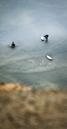 Surfers at Maori Bay