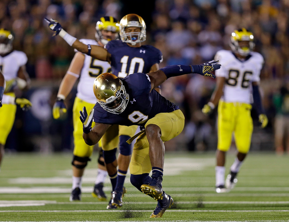 . Notre Dame linebacker Jaylon Smith celebrates a tackle for a loss against Michigan during the second half of an NCAA college football game in South Bend, Ind., Saturday, Sept. 6, 2014. (AP Photo/Michael Conroy)