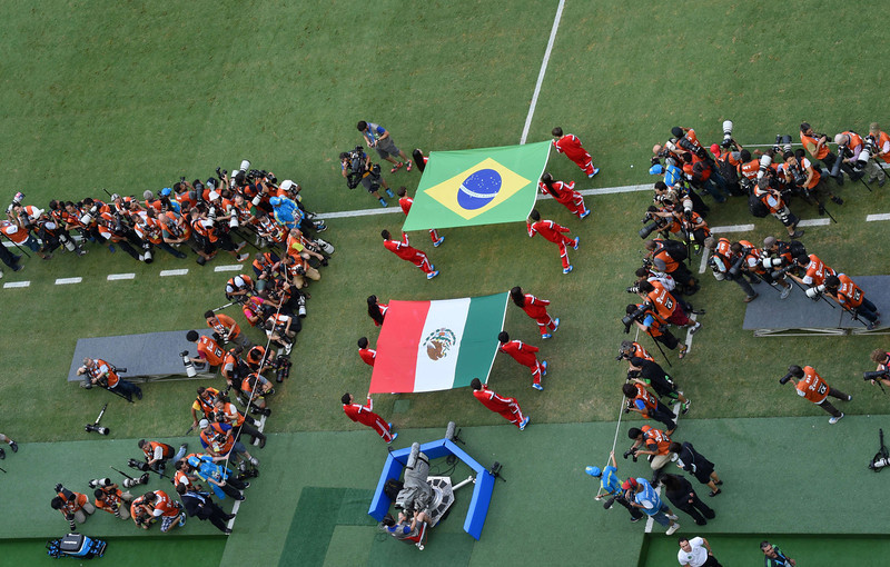 . Brazil (top C) and Mexico (bottom C) are carried out before a Group A football match between Brazil and Mexico in the Castelao Stadium in Fortaleza during the 2014 FIFA World Cup on June 17, 2014. (FRANCOIS XAVIER MARIT/AFP/Getty Images)