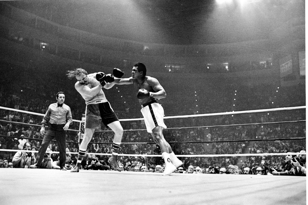. World heavyweight champion Muhammad Ali hits Chuck Wepner with a right during their title bout in the Cleveland Coliseum in Richfield, Ohio, Monday night, March 24, 1975.  Ali knocked Wepner out with only 19 seconds remaining of the 15th round prompting referee Tony Perez to stop the fight.  (AP Photo)