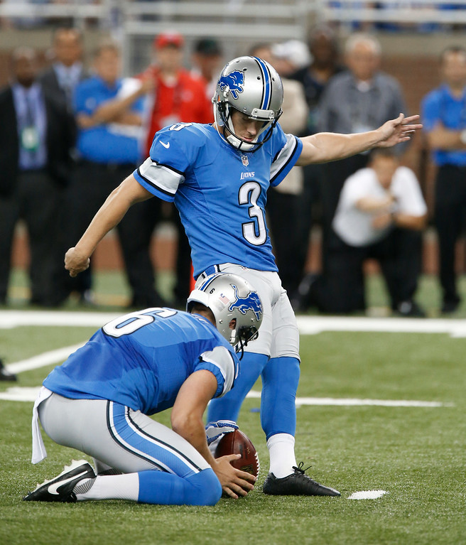 . Detroit Lions kicker Nate Freese (3) kicks a 37-yard field goal out of the hold of Sam Martin (6) against the Cleveland Browns in the first half of a preseason NFL football game at Ford Field in Detroit, Saturday, Aug. 9, 2014.  (AP Photo/Duane Burleson)