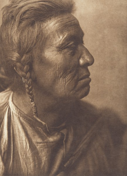 Flathead Woman - Apsaroke (Indians of North America, v. IV. Cambridge, MA: The University Press, 1909)